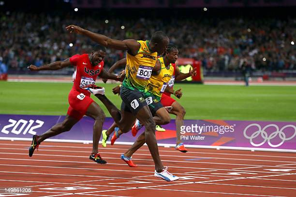 Usain Bolt of Jamaica crosses the finish line ahead of Yohan Blake of Jamaica and Justin Gatlin of the United States to win the Men's 100m Semifinal...