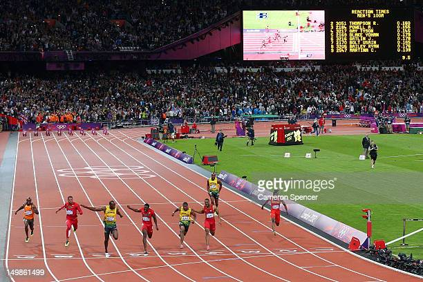 Usain Bolt of Jamaica crosses the finish line ahead of Yohan Blake of Jamaica and Justin Gatlin of the United States to win the Men's 100m Final on...
