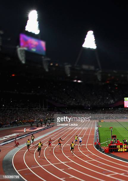 Usain Bolt of Jamaica crosses the finish line ahead of Yohan Blake of Jamaica to win gold during the Men's 200m Final on Day 13 of the London 2012...