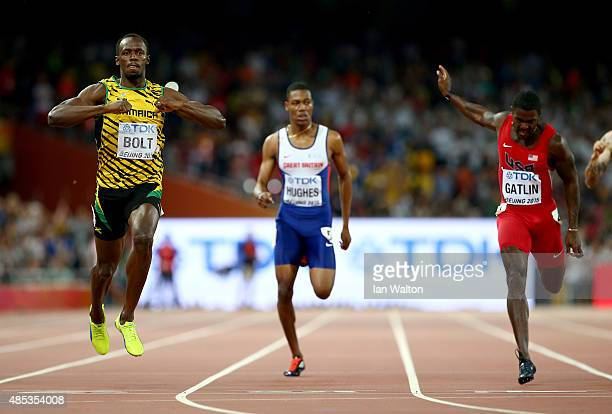 Usain Bolt of Jamaica crosses the finish line to win gold ahead of Justin Gatlin of the United States in the Men's 200 metres final during day six of...