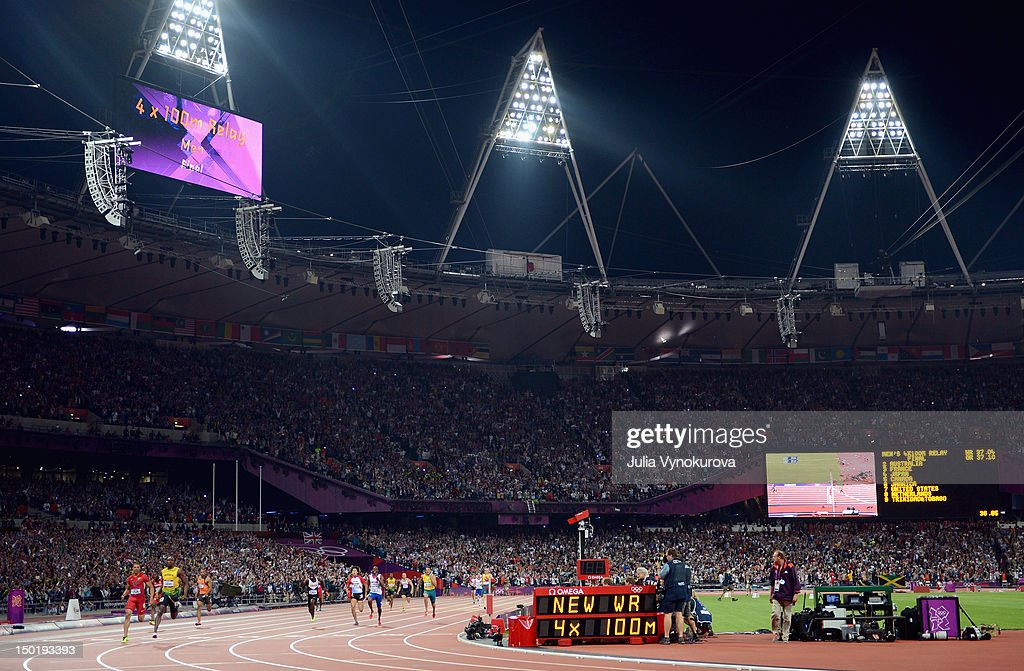 Usain Bolt of Jamaica crosses the finish line to win gold and set a new world record during the Men's 4 x 100m Relay Final on Day 15 of the London 2012 Olympic Games at Olympic Stadium on August 11, 2012 in London, England.