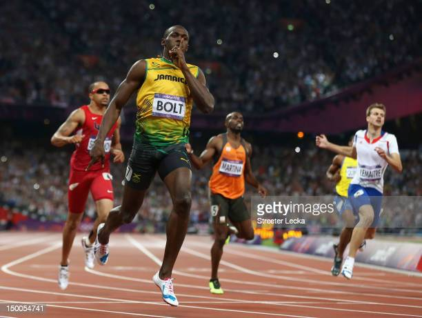 Usain Bolt of Jamaica crosses the finish line to win gold during the Men's 200m Final on Day 13 of the London 2012 Olympic Games at Olympic Stadium...