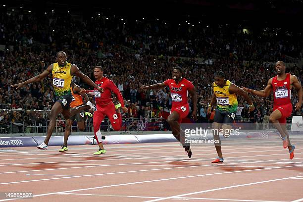 Usain Bolt of Jamaica crosses the finish line to win gold in the Men's 100m Final on Day 9 of the London 2012 Olympic Games at the Olympic Stadium on...