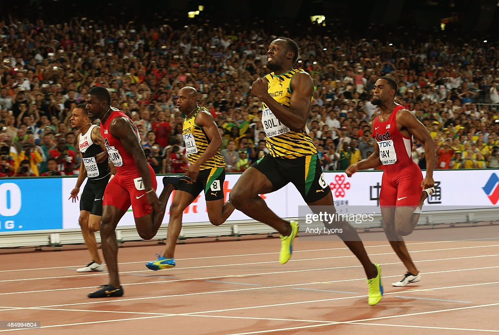 Usain Bolt of Jamaica crosses the finish line to win gold ...
