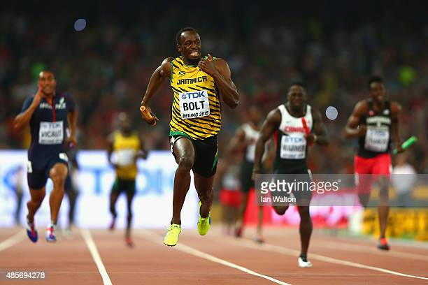 Usain Bolt of Jamaica crosses the finish line to win gold in the Men's 4x100 Metres Relay final during day eight of the 15th IAAF World Athletics...