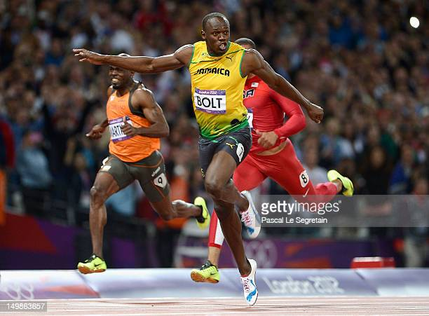 Usain Bolt of Jamaica crosses the finish line to win the gold medal in the Men's 100m Final on Day 9 of the London 2012 Olympic Games at Olympic...