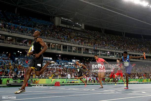 Usain Bolt of Jamaica crosses the finishline to win ahead of Aska Cambridge of Japan and Trayvon Bromell of the United States in the Men's 4 x 100m...