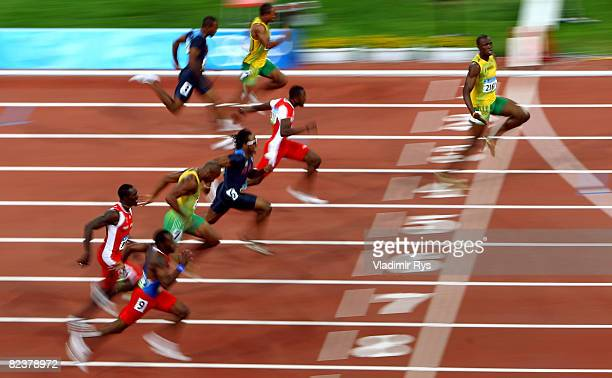 Usain Bolt of Jamaica crosses the line on his way to winning the Men's 100m Final at the National Stadium on Day 8 of the Beijing 2008 Olympic Games...