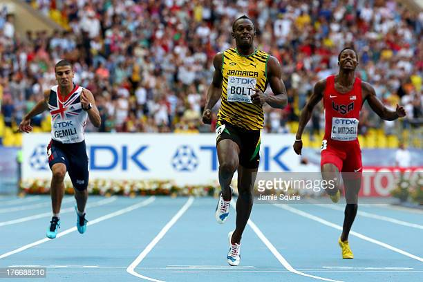 Usain Bolt of Jamaica crosses the line to win gold ahead of Adam Gemili of Great Britain and Curtis Mitchell of the United States in the Men's 200...