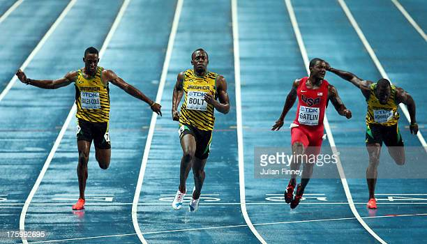 Usain Bolt of Jamaica crosses the line to win gold ahead of Kemar Bailey-Cole of Jamaica, Justin Gatlin of the United States, Nickel Ashmeade of...