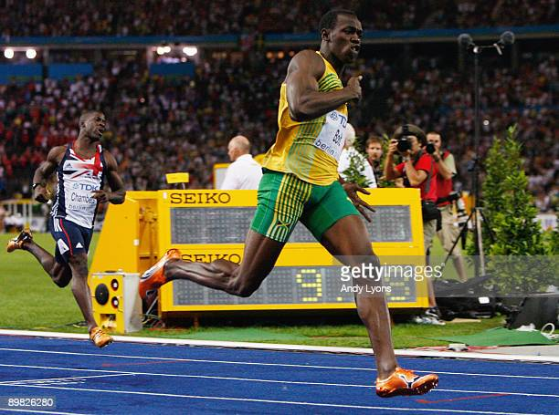 Usain Bolt of Jamaica crosses the line to win the gold medal in the men's 100 Metres Final during day two of the 12th IAAF World Athletics...