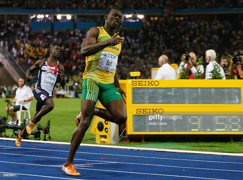 Usain Bolt of Jamaica crosses the line to win the gold ...