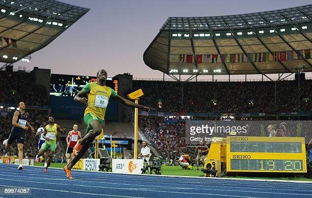 Usain Bolt of Jamaica crosses the line to win the gold medal in the men's 200 Metres Final during day six of the 12th IAAF World Athletics...