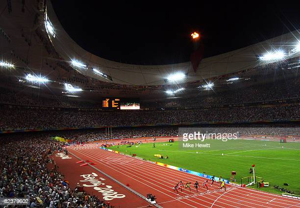 Usain Bolt of Jamaica crosses the line to win the Men's 100m Final at the National Stadium on Day 8 of the Beijing 2008 Olympic Games on August 16...