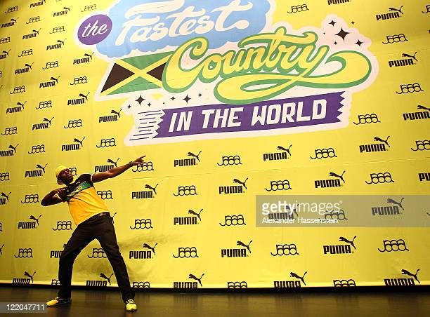 Usain Bolt of Jamaica entertains the crowd at the PUMA - JAAA press conference prior to the IAAF World Athletics Championships at the Daeduk Cultural...