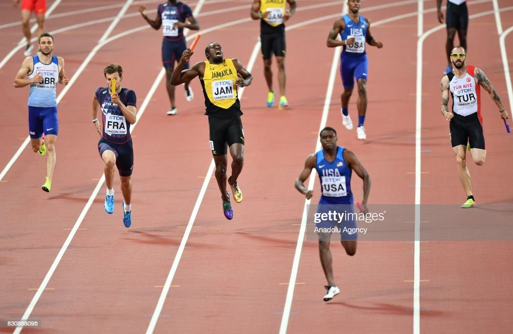 Usain Bolt (C) of Jamaica falls as Ramil Guliyev (R) of Turkey, Christophe Lemaitre of France compete during the Men's 4x100 Relay final at the 'IAAF Athletics World Championships London 2017' at London Stadium in the Queen Elizabeth Olympic Park in London, United Kingdom on August 12, 2017.