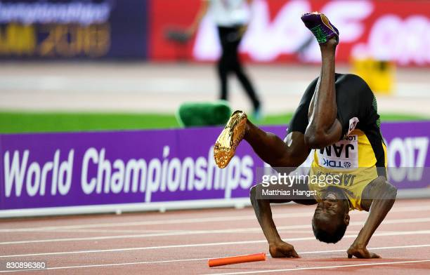 Usain Bolt of Jamaica falls to the track in the Men's 4x100 Relay final during day nine of the 16th IAAF World Athletics Championships London 2017 at...