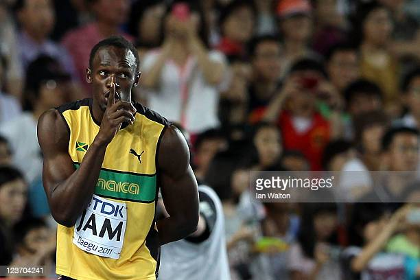 Usain Bolt of Jamaica gestures after claiming victory and a new world record in the men's 4x100 metres relay final during day nine of 13th IAAF World...