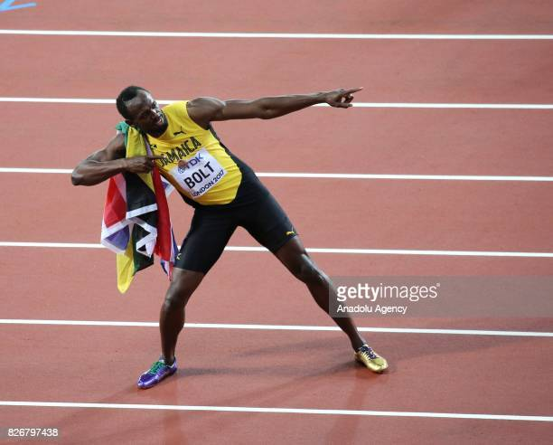 Usain Bolt of Jamaica greets spectator after winning third place in the men's 100m final during the 'IAAF Athletics World Championships London 2017'...