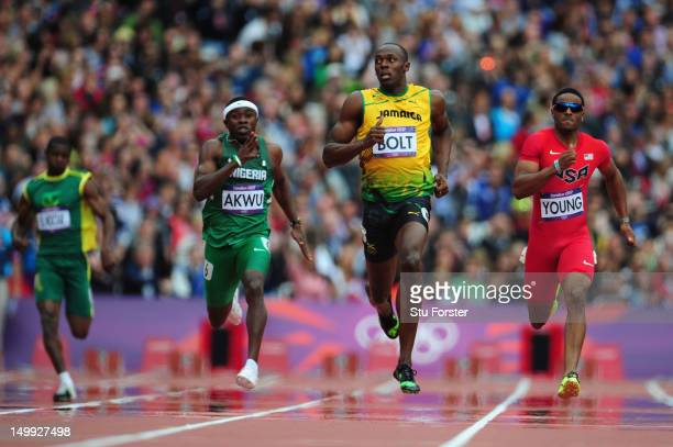 Usain Bolt of Jamaica leads Noah Akwu of Nigeria and Isiah Young of the United States in the Men's 200m Round 1 Heats on Day 11 of the London 2012...