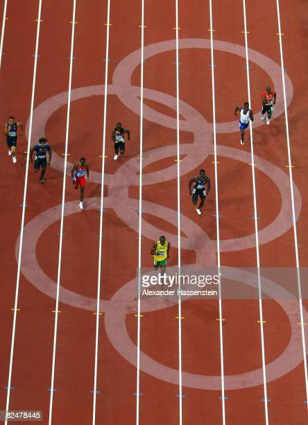 Usain Bolt of Jamaica leads on his way to breaking the world record with a time of 1930 seconds to win the gold medal in the Men's 200m Final at the...