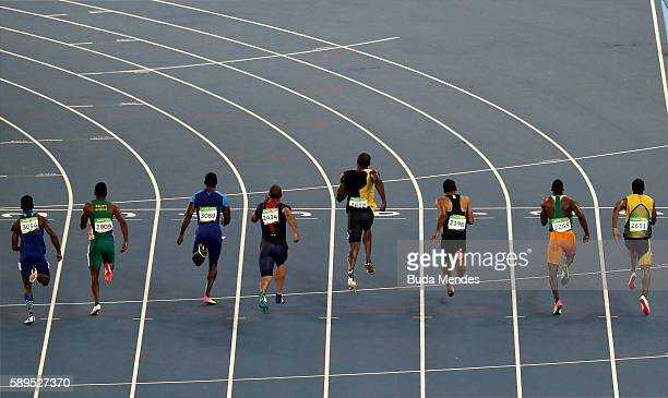 Usain Bolt of Jamaica leads the Men's 100 meter final to win ahead of Justin Gatlin of the United States and Andre De Grasse of Canada on Day 9 of...