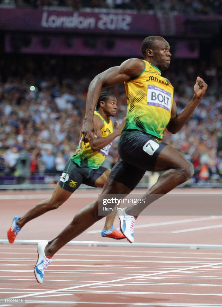 Usain Bolt of Jamaica leads Yohan Blake of Jamaica on his way to winning gold in the Men's 200m Final on Day 13 of the London 2012 Olympic Games at Olympic Stadium on August 9, 2012 in London, England.