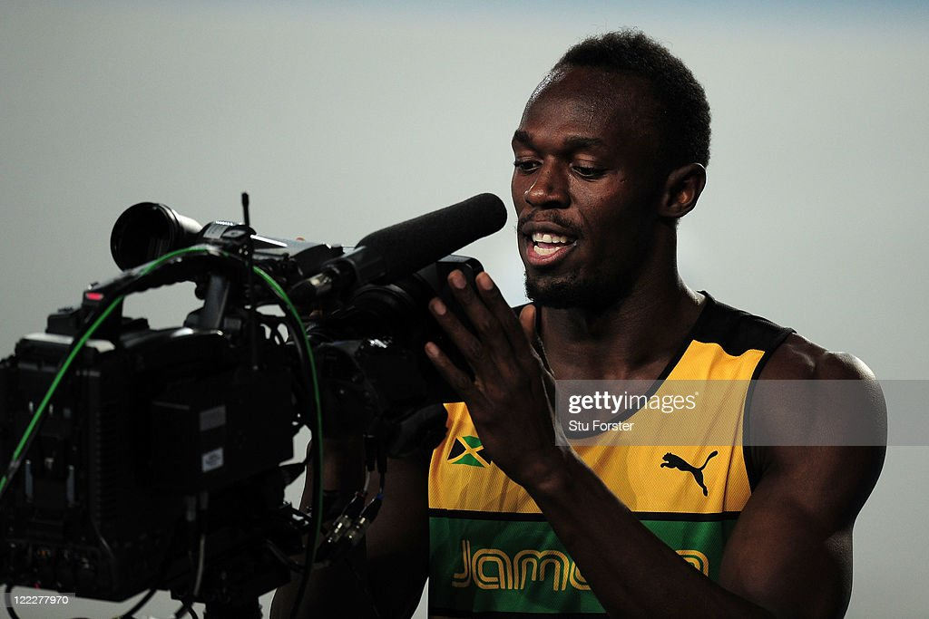 Usain Bolt of Jamaica looks into a television camera after winning his men's 100 metres heats during day one of the 13th IAAF World Athletics Championships at the Daegu Stadium on August 27, 2011 in Daegu, South Korea.
