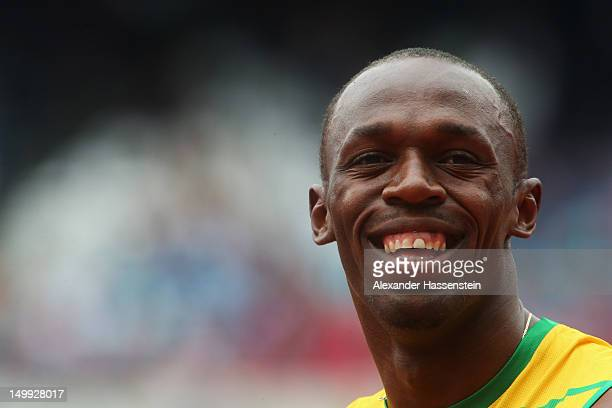 Usain Bolt of Jamaica looks on after competing in the Men's 200m Round 1 Heats on Day 11 of the London 2012 Olympic Games at Olympic Stadium on...