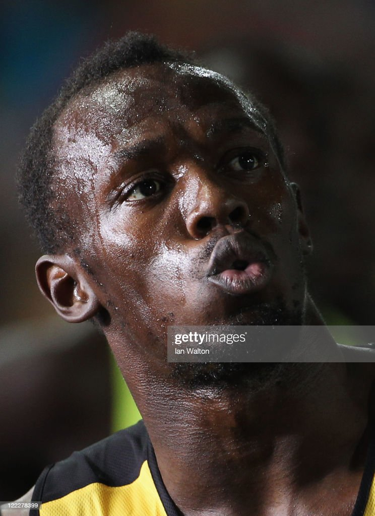 Usain Bolt of Jamaica looks on after the men's 100 metres heats during day one of the 13th IAAF World Athletics Championships at the Daegu Stadium on August 27, 2011 in Daegu, South Korea.