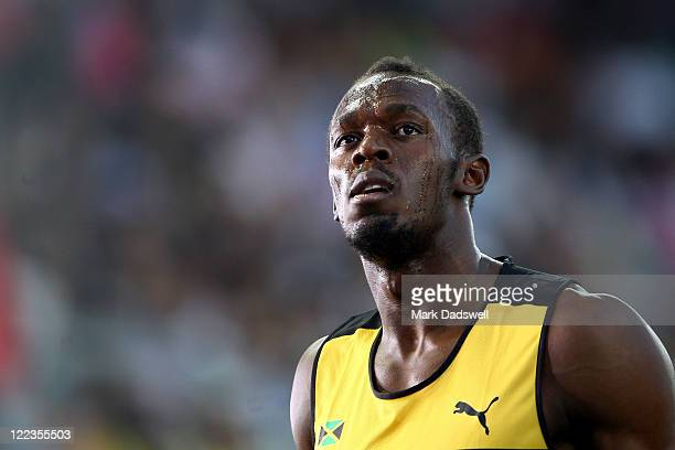Usain Bolt of Jamaica looks on after winning his men's 100 metres semi finals during day two of the 13th IAAF World Athletics Championships at the...