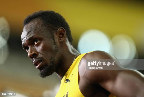 Usain Bolt of Jamaica looks on during a lap of honour following finishing in third place in the mens 100m final during day two of the 16th IAAF World...