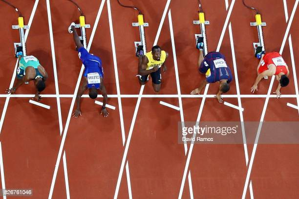 Usain Bolt of Jamaica looks to the skies before settling into his blocks before the Men's 100 metres final during day two of the 16th IAAF World...