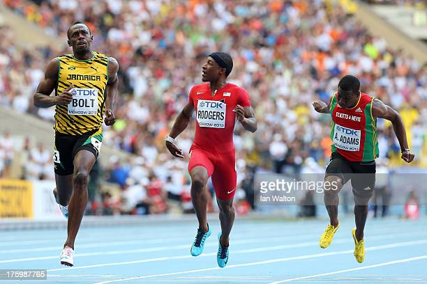 Usain Bolt of Jamaica Mike Rodgers of the United States and Antoine Adams of Saint Kitts and Nevis compete in the Men's 100 metres semi final during...