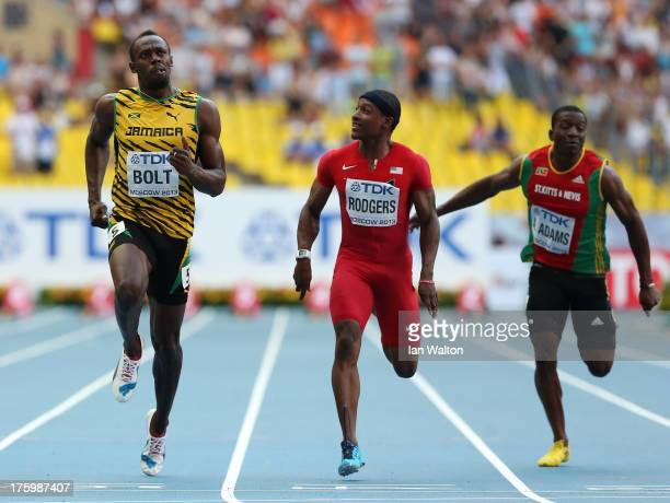 Usain Bolt of Jamaica Mike Rodgers of the United States and Usain Bolt of Jamaica Antoine Adams of Saint Kitts and Nevis compete in the Men's 100...