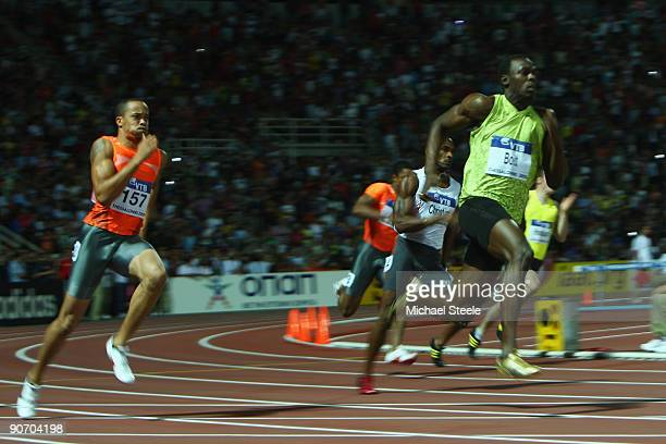 Usain Bolt of Jamaica on his way to victory in the men's 200m during day two of the IAAF World Athletics Final at the Kaftanzoglio Stadium on...