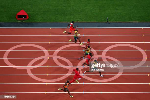 Usain Bolt of Jamaica on his way to winning gold in the Men's 100m Final on Day 9 of the London 2012 Olympic Games at the Olympic Stadium on August 5...
