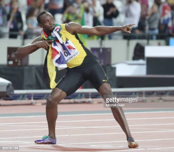 Usain Bolt of Jamaica performs his trademark move after the 100 metres final during day two of the 16th IAAF World Athletics Championships London...