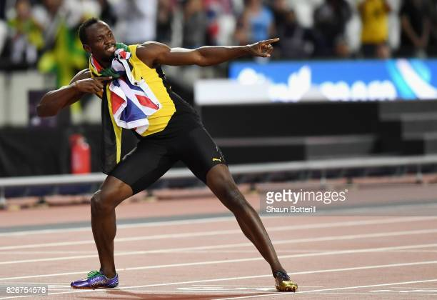 Usain Bolt of Jamaica performs the Lightning Bolt pose following his third place finish in the Men's 100 metres final during day two of the 16th IAAF...
