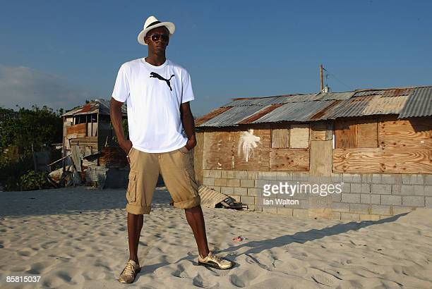 Usain Bolt of Jamaica poses during a photo shoot at the Hellshire beach on April 5, 2009 in Kingston, Jamaica.