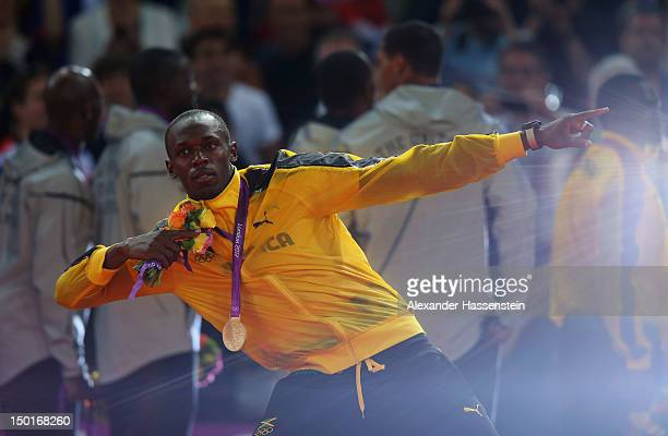 Usain Bolt of Jamaica poses on the podium during the medal ceremony for the Men's 4 x 100m Relay on Day 15 of the London 2012 Olympic Games at...