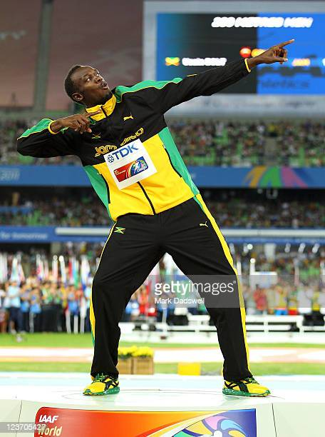Usain Bolt of Jamaica poses with his gold medal during the medal ceremony for the men's 200 metres final during day nine of 13th IAAF World Athletics...
