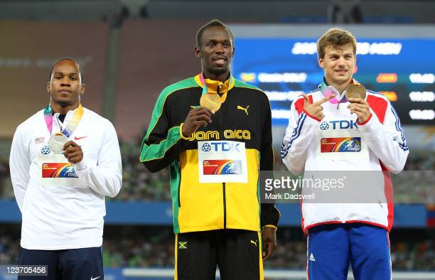 Usain Bolt of Jamaica poses with his gold medal, Walter Dix of the USA his silver and Christophe Lemaitre of France his bronze during the medal...
