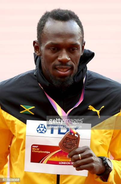 Usain Bolt of Jamaica poses with the bronze medal for the Men's 100 metres during day three of the 16th IAAF World Athletics Championships London...