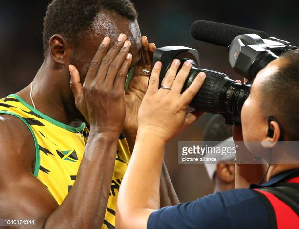 Usain Bolt of Jamaica prepares for the Men's 100 M Final at the 15th International Association of Athletics Federations Athletics World Championships...
