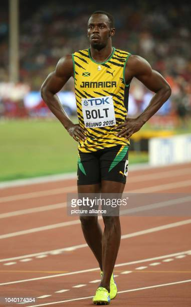 Usain Bolt of Jamaica prepares for the start in the Men's 100 M Qualification at the 15th International Association of Athletics Federations...