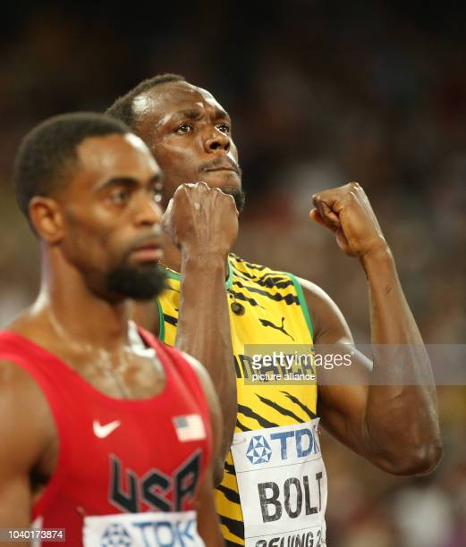 Usain Bolt of Jamaica prepares next to Tyson Gay of the USA for the Men's 100 M Final at the 15th International Association of Athletics Federations...