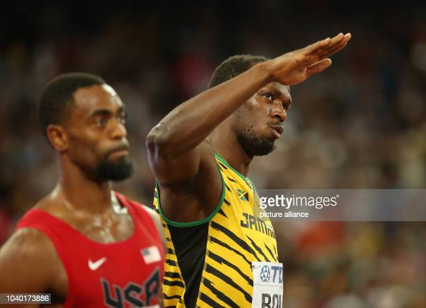 Usain Bolt of Jamaica prepares next to Tyson Gay of USA for the Men's 100 M Final at the 15th International Association of Athletics Federations...