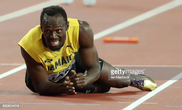 Usain Bolt of Jamaica pulls up during the Men's 4x100m Relay final during day nine of the 16th IAAF World Athletics Championships London 2017 at The...