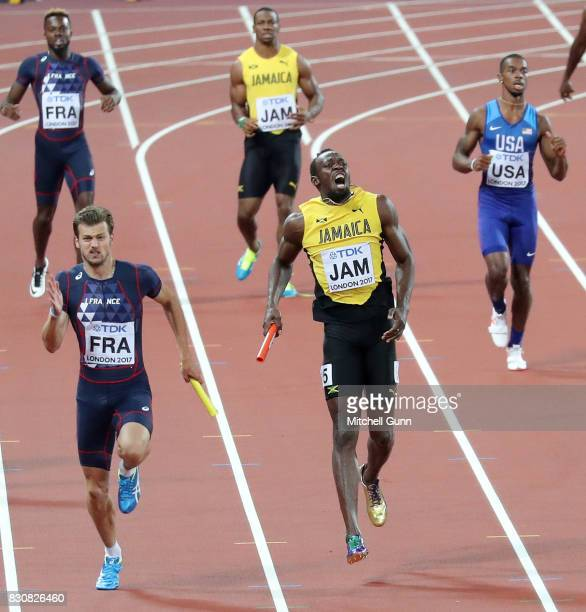 Usain Bolt of Jamaica pulls up injured whilst competing in the 100 metres relay final during day nine of the 16th IAAF World Athletics Championships...